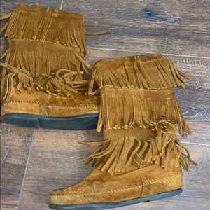 Fringe boots by Minnetonka